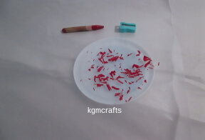 shave a color crayon on wax paper