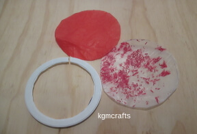 cut a circle from tissue and the wax paper