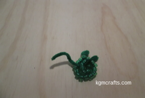 bend the pipe cleaner under the center beads