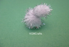 glue two pompoms together