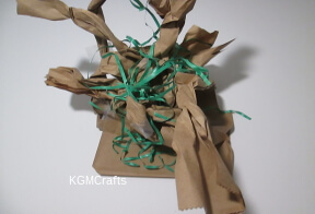 add shredded gift paper