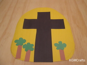 cut tomb, cross, and trees from paper