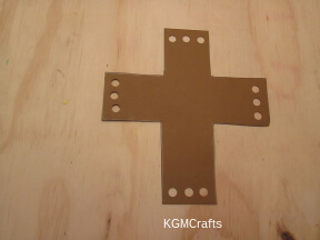 cut a cross shape and punch holes