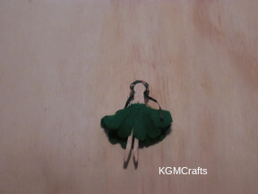 add the hair and skirt to the clothespin