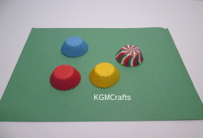 different colored cupcake liners on paper