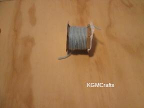 wrap the yarn around the spool