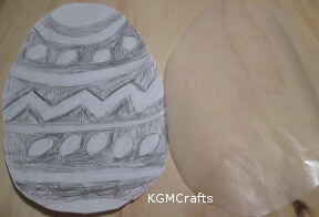 draw designs on a paper egg shape