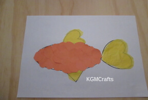 cut circles from construction paper and glue to fish