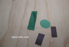 cut a larger circle, tissue, and black rectangles