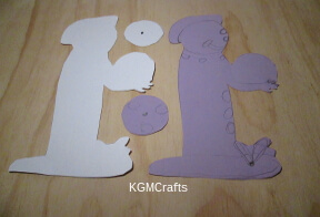 cut out a clown shape from cardstock and colored paper