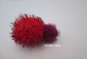 glue the red and purple pompoms together
