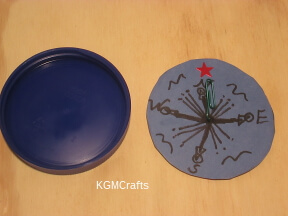 finish the compass and glue to the lid
