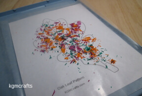 fold the wax paper over the crayon shavings