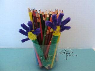 pipe cleaner flowers on a craft sticks