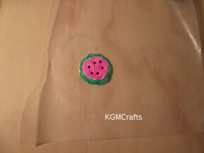 place pink circle in larger one add beads