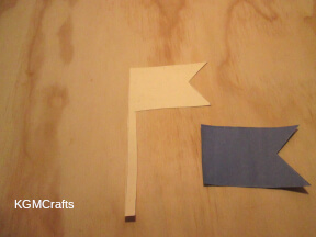 cut a flag shape from cardboard and construction paper