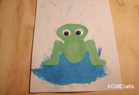 glue the frog on the puddle