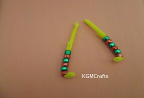 continue adding beads to arms