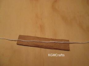 cut a piece of cardboard and yarn