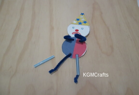 decorate clown and add straw legs