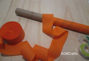 wrap cardboard roll with orange streamer