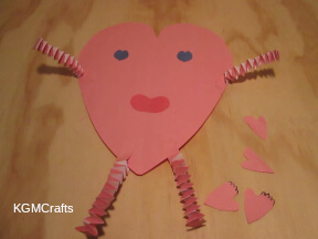 glue the arms and legs to the large heart.