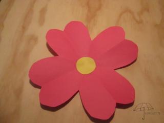 a folded paper flower
