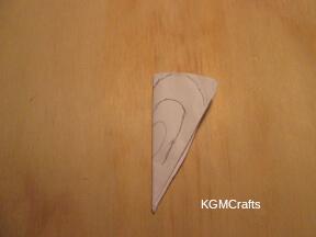 cut a circle and fold into a cone shape