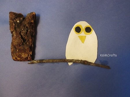 owl on lim made with bark and twig
