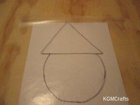 draw Santa's head and hat on wax paper