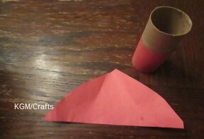 cut paper for hat and to cover cardboard tube.